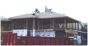 [19 August: After two day's  work, the roof is complete with the installation of shingles and flashing.  Like our blue roof?]