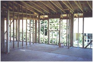 "[13 August: This view is from the living room toward the kitchen.  The room behind the kitchen will be our ""den"".]"