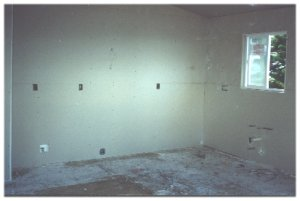[03 September: Drywall installed and taped.  This is the view of the kitchen area taken from the living room.]