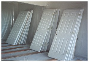 [25 September: Door Country???  All the interior doors lined up in the garage ready for their final coat of semi-gloss.]