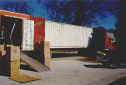 [March 19, 1999: Our container being loaded in Bay City, Michigan.]