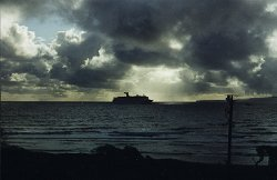 [April 26, 1999: Early one Sunday morning we awoke to see Carnival Cruise Line <i>Jubilee</i> entering Kahului Harbor.  We get to see all the ships and barges.] style=