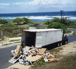 [April 24, 1999: Well they must have found it; here it is being unloaded at our Wailuku rental home (yes, that is the ocean in the background!)]