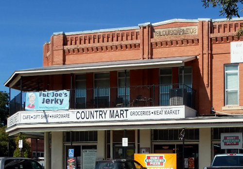 [Storefront with the Country Mart (Building from 1908)]
