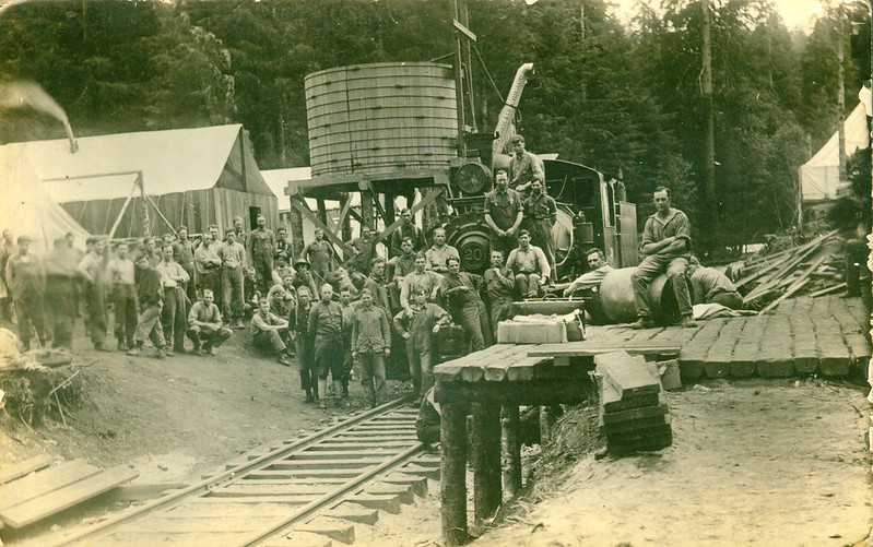 [Photo of Members of the 69th Spruce Squadron with a Steam Locomotive]