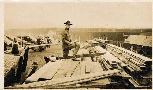 [Soldier Inspecting Processed Lumber at Vancouver Barracks]